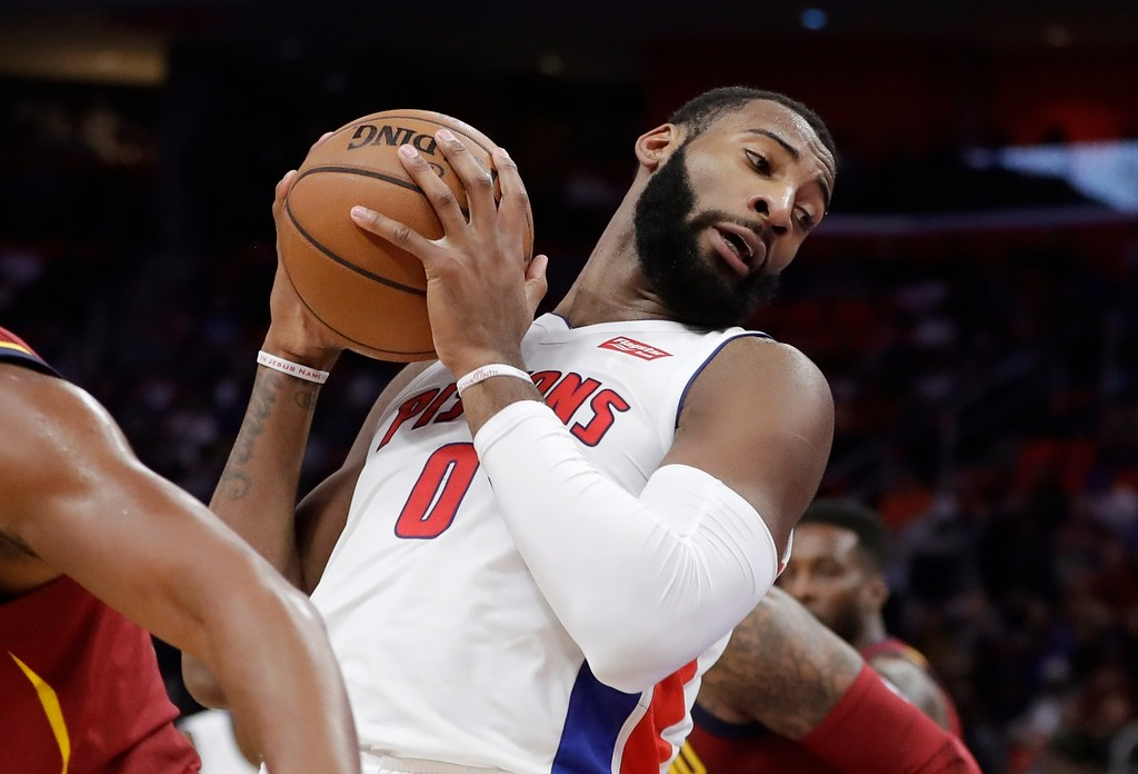 . Detroit Pistons center Andre Drummond pulls down a rebound during the first half of an NBA basketball game against the Cleveland Cavaliers, Monday, Nov. 20, 2017, in Detroit. (AP Photo/Carlos Osorio)