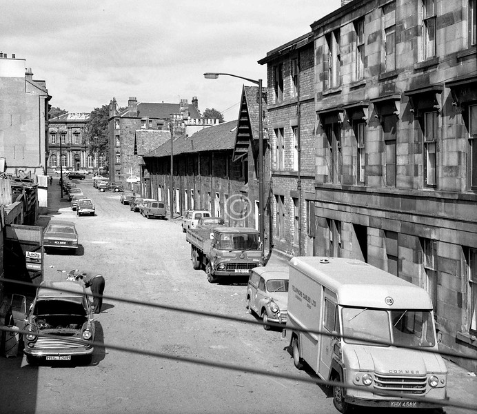 Baker St., looking north.   The terrace with the boldly overhanging eaves has been attributed to Alexander Thomson. It and all this end of the street have been replaced by new housing.    June 1973