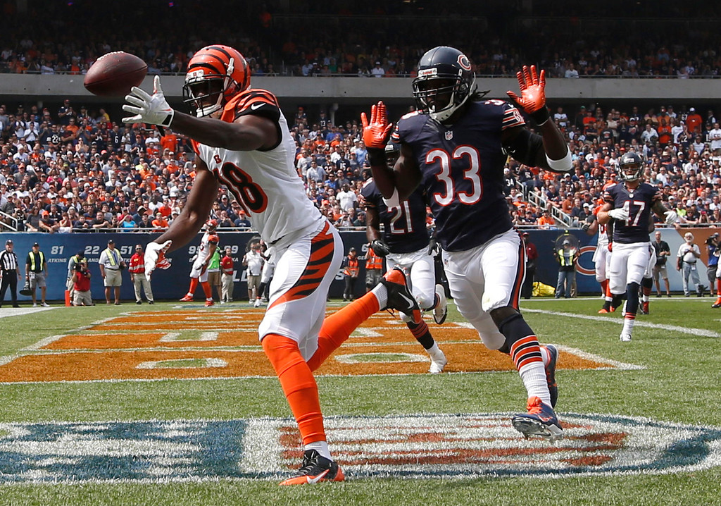 . Cincinnati Bengals wide receiver A.J. Green (18) misses a catch in the end zone against Chicago Bears cornerback Charles Tillman (33) during the first half of an NFL football game, Sunday, Sept. 8, 2013, in Chicago. (AP Photo/Charles Rex Arbogast)