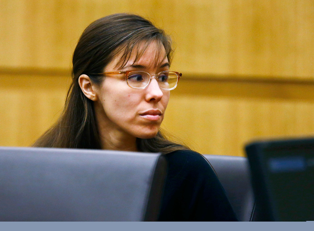 . Defendant Jodi Arias looks to her family during closing arguments during her trial on Friday, May 3, 2013 at Maricopa County Superior Court in Phoenix.  Arias is charged with first-degree murder in the stabbing and shooting death of Travis Alexander, 30, in his suburban Phoenix home in June 2008. (AP Photo/The Arizona Republic, Rob Schumacher, Pool)