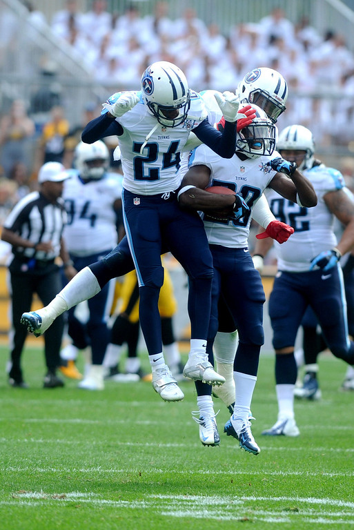 . Alterraun Verner  #20 of the Teneessee Titans celebrates his interception against the Pitsburgh Steelers with teammate Cory Sensabaugh # 24 of the Tennessee Titans during the third quarter at Heinz Field on September 8, 2013 in Pittsburgh, Pennsylvania. (Photo by Vincent Pugliese/Getty Images)