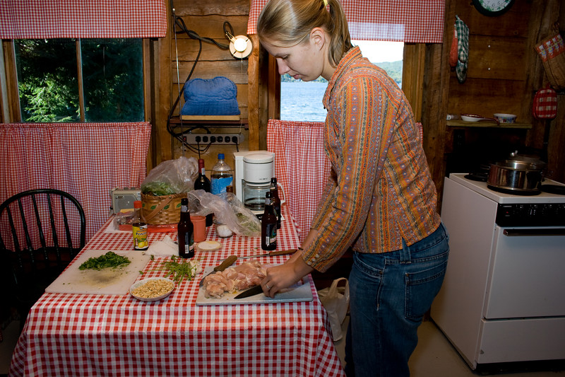 Abby chopping chicken for Pad Thai.