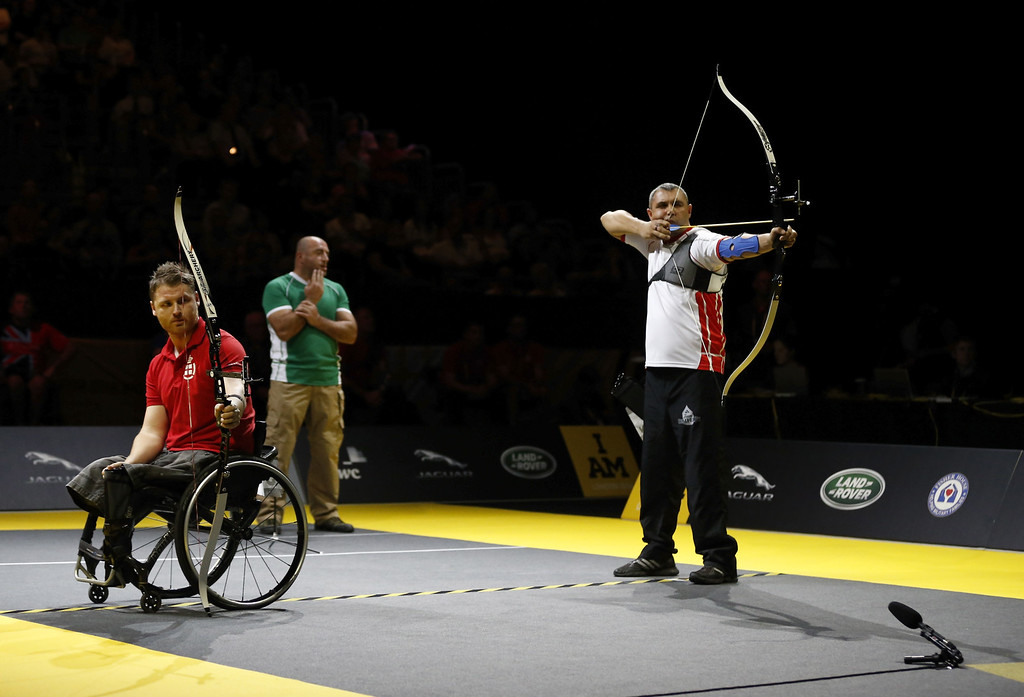 . Malkhaz Shekelashvili of Georgia in action against Christian Richardson of Denmark during the novice open archery at Olympic Park on September 12, 2014 in London, England. Photo:  (Photo by Steve Bardens/Getty Images for Invictus Games)