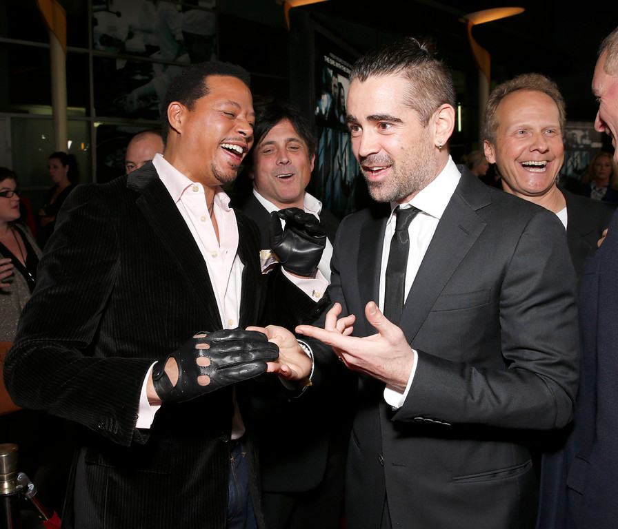 """. Colin Farrell admires Terrence Howard\'s gloves at the world premiere of \""""Dead Man Down\"""" at the Archlight Hollywood on Tuesday , Feb. 26, 2013 in Los Angeles. (Photo by Todd Williamson/Invision/AP)"""