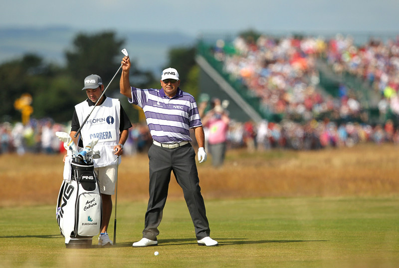 """. Argentina\'s Angel Cabrera (R) on the 2nd fairway during his first round on the opening day of the 2014 British Open Golf Championship at Royal Liverpool Golf Course in Hoylake, north west England on July 17, 2014. England\'s former Ryder Cup star David Howell got the 143rd British Open underway just after the crack of dawn at Royal Liverpool Golf Club on Thursday with all eyes early on riveted on a \""""fit again\"""" Tiger Woods. (PETER MUHLY/AFP/Getty Images)"""