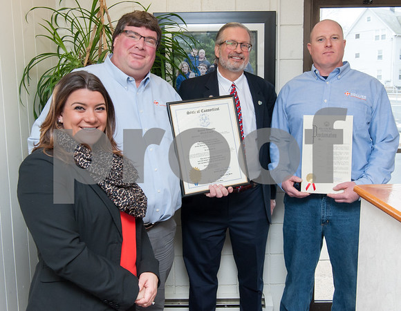 02/20/18 Wesley Bunnell | Staff Collier Electric Corp celebrated 25 years in business with presentations on Tuesday morning by Mayor Erin Stewart and Representative William Petit Jr. Mayor Erin Stewart, L, Collier Electric Corp President Scott Pehmoeller, Representative William Petit Jr, and Collier Vice President and Secretaty Bryson Burse.