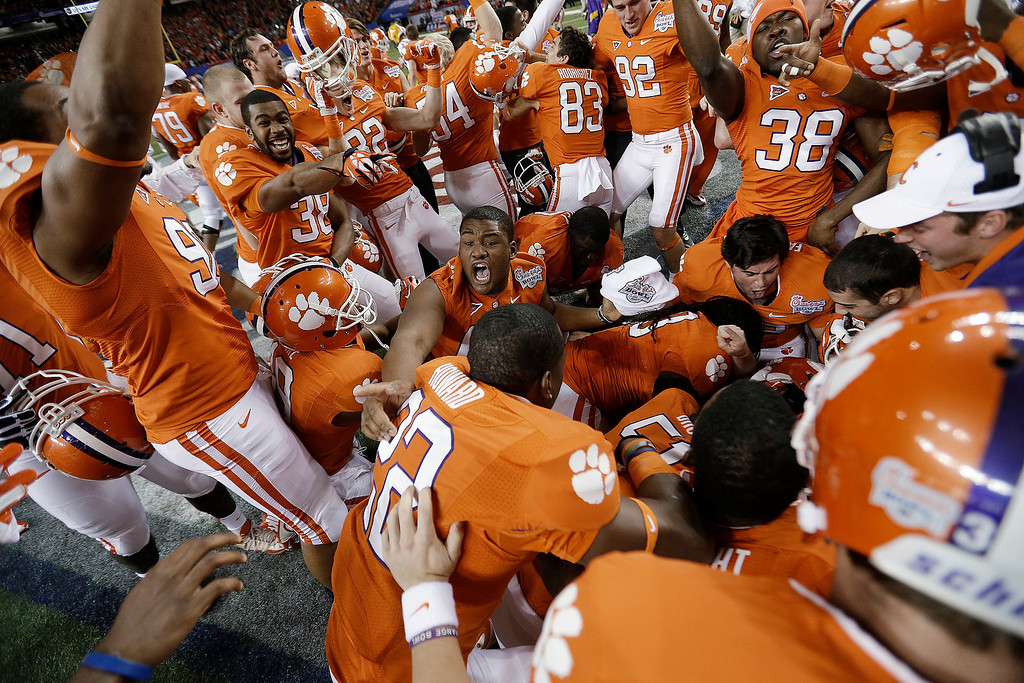 . Clemson players pile up in the middle of the field after the Chick-fil-A Bowl NCAA college football game against LSU, Monday, Dec. 31, 2012, in Atlanta. Clemson won 25-24 on a field goal as time expired. (AP Photo/David Goldman)