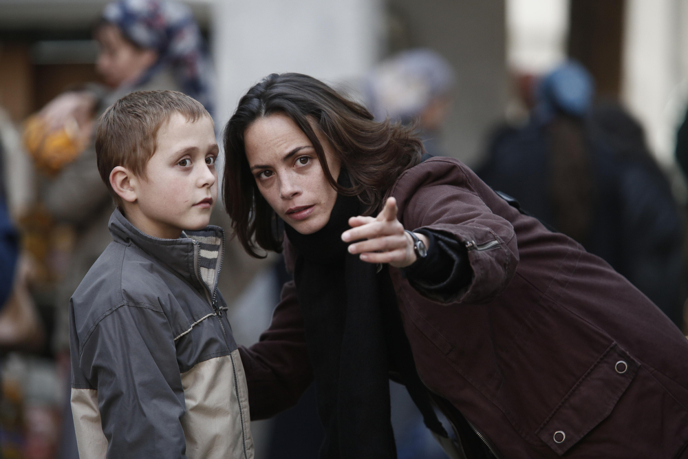 ". This image released by Cannes Film Festival shows Bérénice Bejo, right, in a scene from ""The Search,\"" a film by Michel Hazanavicius. (AP Photo/Cannes Film Festival)"