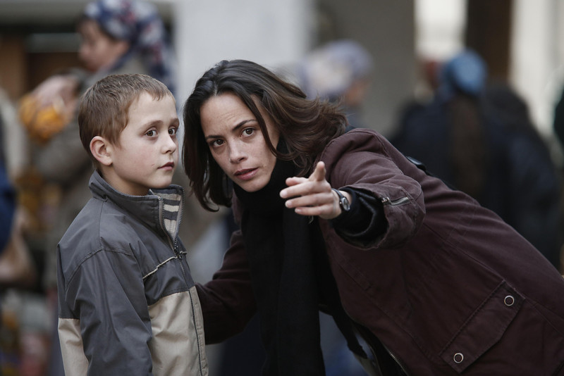 """. This image released by Cannes Film Festival shows Bérénice Bejo, right, in a scene from \""""The Search,\"""" a film by Michel Hazanavicius. (AP Photo/Cannes Film Festival)"""