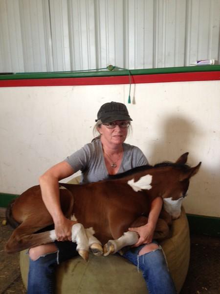 Martha with Foal in Lap.JPG