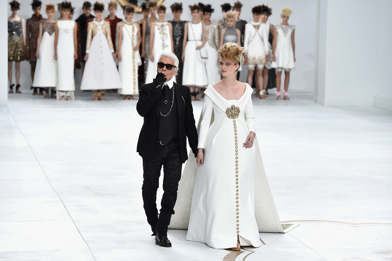 . Fashion designer Karl Lagerfeld (L) acknowledges the applause of the audience after the Chanel show as part of Paris Fashion Week - Haute Couture Fall/Winter 2014-2015 at Grand Palais on July 8, 2014 in Paris, France.  (Photo by Pascal Le Segretain/Getty Images)