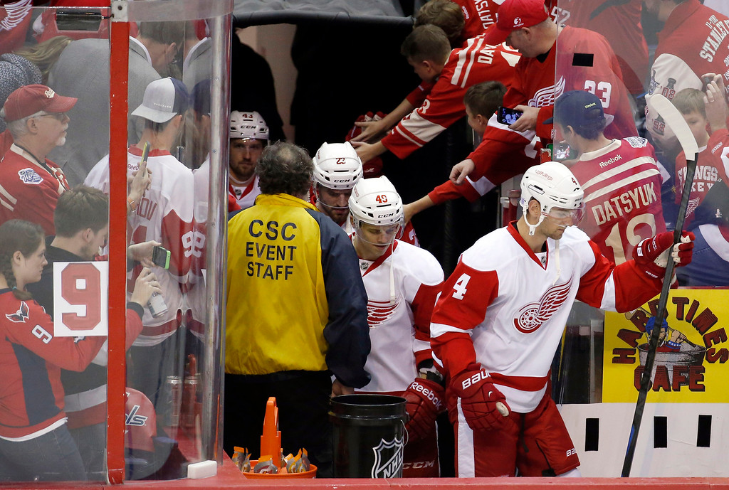 """. A number \""""9\"""" is taped to the glass to honor former Detroit Red Wing Gordie Howe, who recently had a stroke, as the Detroit Red Wings take to the ice for warm ups before an NHL hockey game against the Washington Capitals, Wednesday, Oct. 29, 2014, in Washington. (AP Photo/Alex Brandon)"""