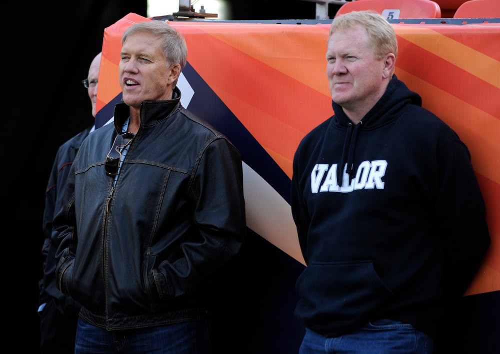 . Former Broncos greats John Elway, left, and Karl Mecklenburg watch the 5A game from the sidelines. Cherokee Trail High School takes on Valor Christian High School in the 5A Colorado State Football Championships at Sports Authority Field at Mile High in Denver on Saturday, Dec. 1, 2012. Kathryn Scott Osler, The Denver Post