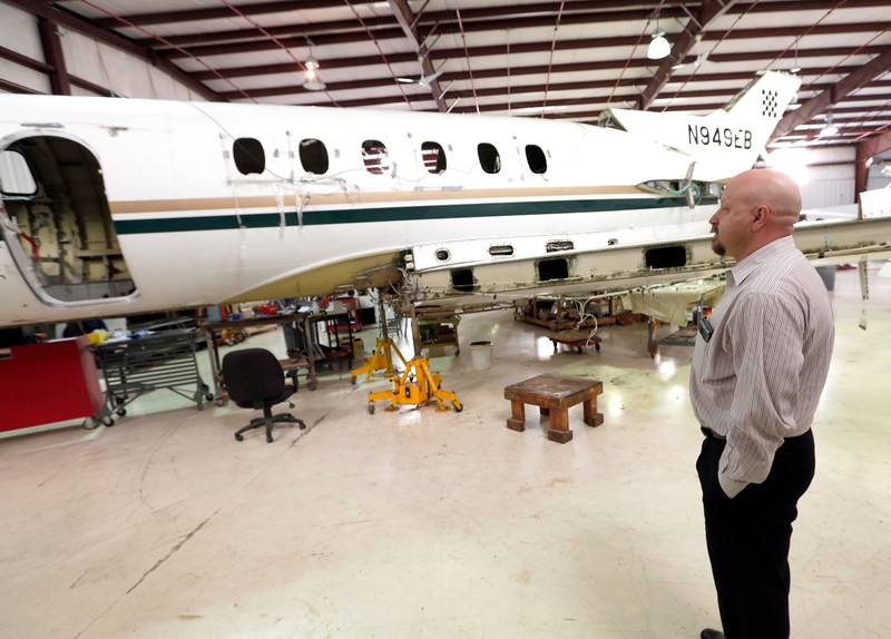 Dave Gusman, General Manager of Southwest Aviation Specialties, inspects an aircraft that is being dismantled for parts at the companies hanger at the RL Jones airport in Jenks.