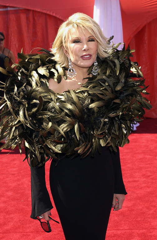 . Joan Rivers with E! Entertainment television arrives for the 55th Annual Primetime Emmy Awards on Sunday, Sept. 21, 2003, at the Shrine Auditorium on Los Angeles. (AP Photo/Laura Rauch)