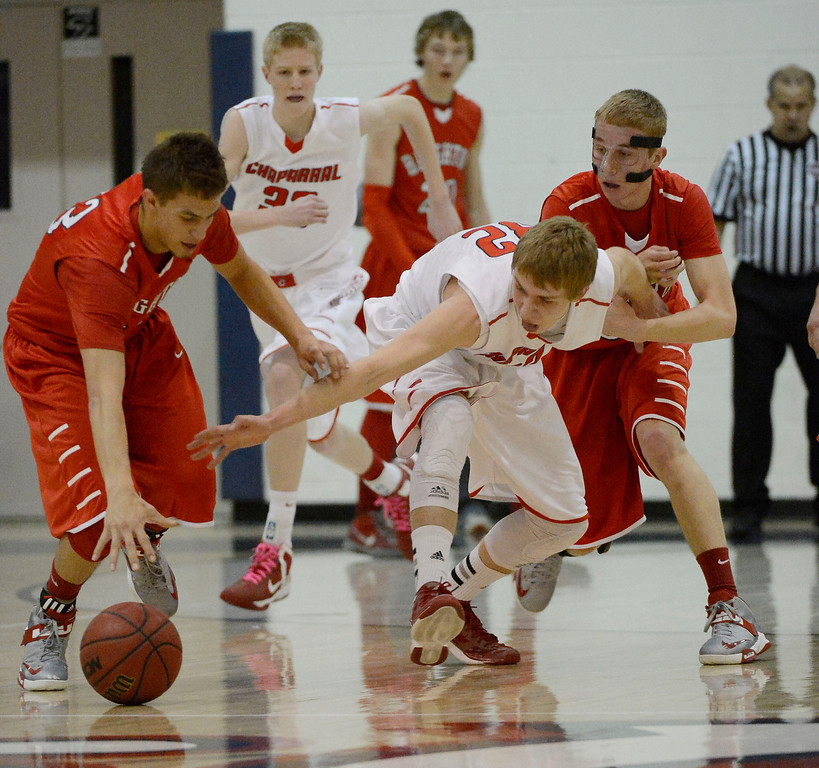 . Brighton\'s Collin Tabor (33) and Michael Goward (32) scramble for a loose ball with Chris Moody (32) during the first quarter against Chaparral February 27, 2013. (Photo By John Leyba/The Denver Post)