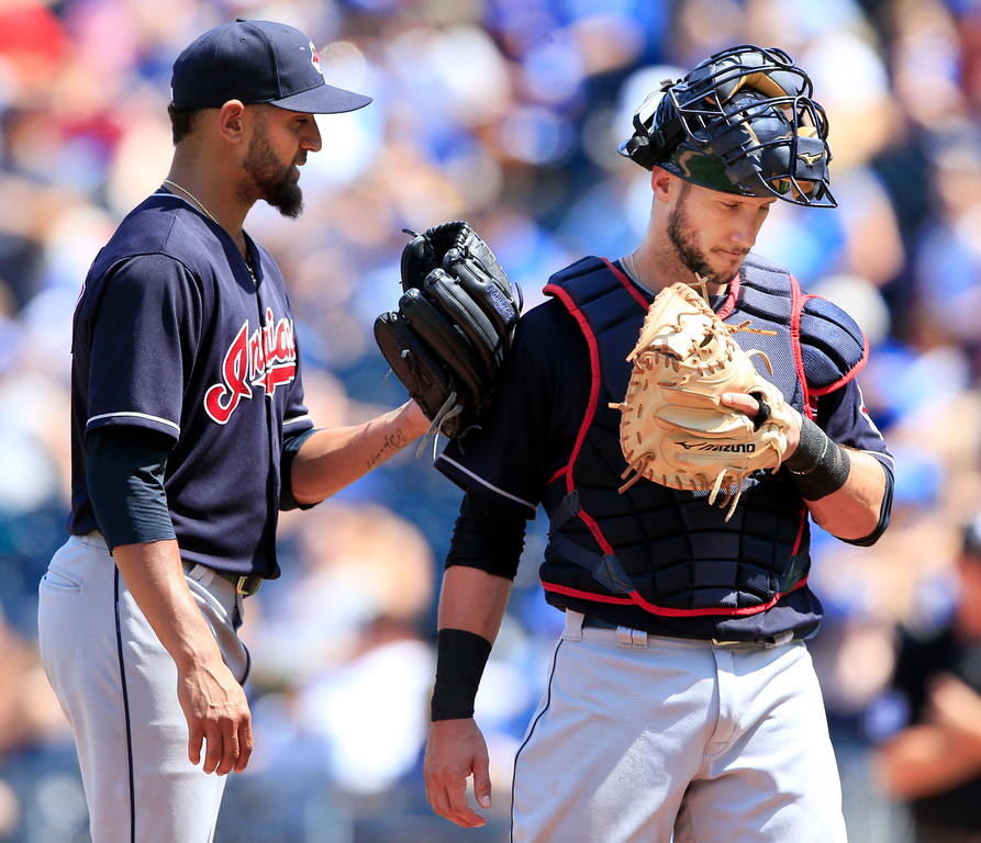 . Cleveland Indians starting pitcher Danny Salazar, left, and catcher Yan Gomes, right, talks after giving up a home run during the fourth inning of a baseball game against the Kansas City Royals at Kauffman Stadium in Kansas City, Mo., Sunday, Aug. 20, 2017. (AP Photo/Orlin Wagner)