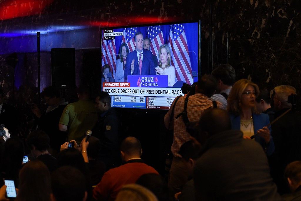. Journalists gather around a television at Trump Tower on May 3, 2016 in New York showing Ted Cruz speaking from Indianapolis as they await the arrival of US Republican presidential candidate Donald Trump.  Ted Cruz suspended his White House campaign on Tuesday after suffering a crushing defeat in Indiana\'s primary, leaving the road wide open for Donald Trump to seize the Republican nomination. (JEWEL SAMAD/AFP/Getty Images)