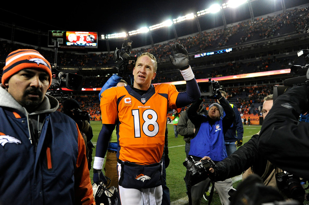 . Denver Broncos quarterback Peyton Manning (18) waves to the fans in the stands after the Broncos beat the Charger 24-17. The Denver Broncos vs. The San Diego Chargers in an AFC Divisional Playoff game at Sports Authority Field at Mile High in Denver on January 12, 2014. (Photo by Joe Amon/The Denver Post)