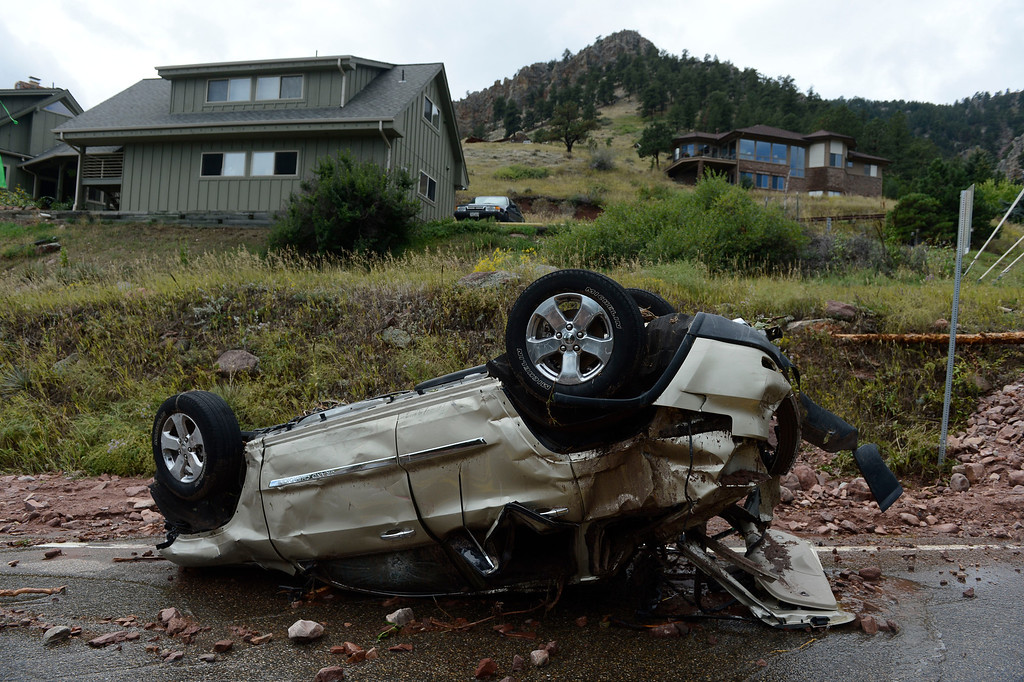 . BOULDER, CO - SEPTEMBER 13: An overturned vehicle sits on Linden Road near S. Cedar Brook Rd. in Boulder Colorado Friday afternoon, September 13, 2013. (Photo By Andy Cross/The Denver Post)
