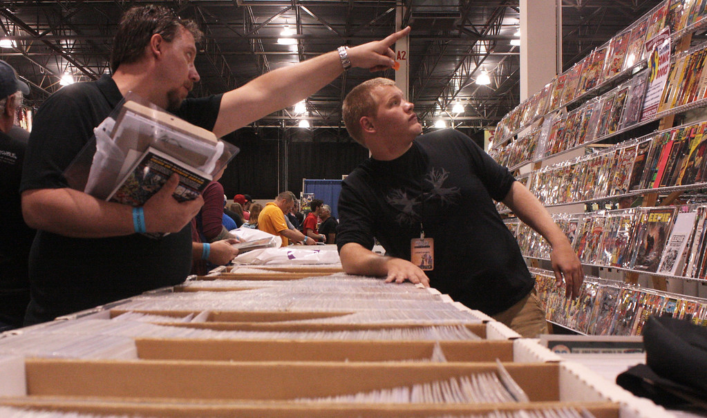 . A man asks for a specific comic along the wall at the Motor City Comic Con. (Photo by Erica McClain)