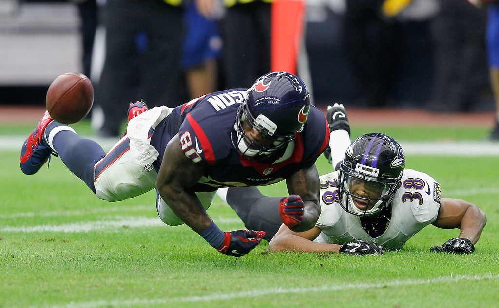. HOUSTON, TX - DECEMBER 21:  Andre Johnson #80 of the Houston Texans is unable to hold onto the ball as he his defended by Rashaan Melvin #38 of the Baltimore Ravens at NRG Stadium on December 21, 2014 in Houston, Texas.  (Photo by Bob Levey/Getty Images)