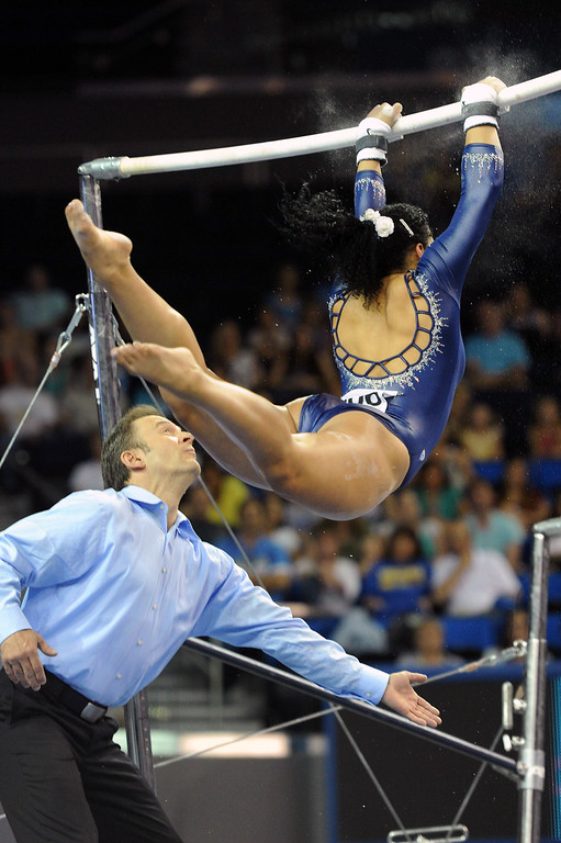 . UCLA\'s Sophina DeJesus performs on the uneven parallel bars at the NCAA Women\'s Gymnastics Championship Team Finals at Pauley Pavilion, Saturday, April 20, 2013. (Michael Owen Baker/Staff Photographer)