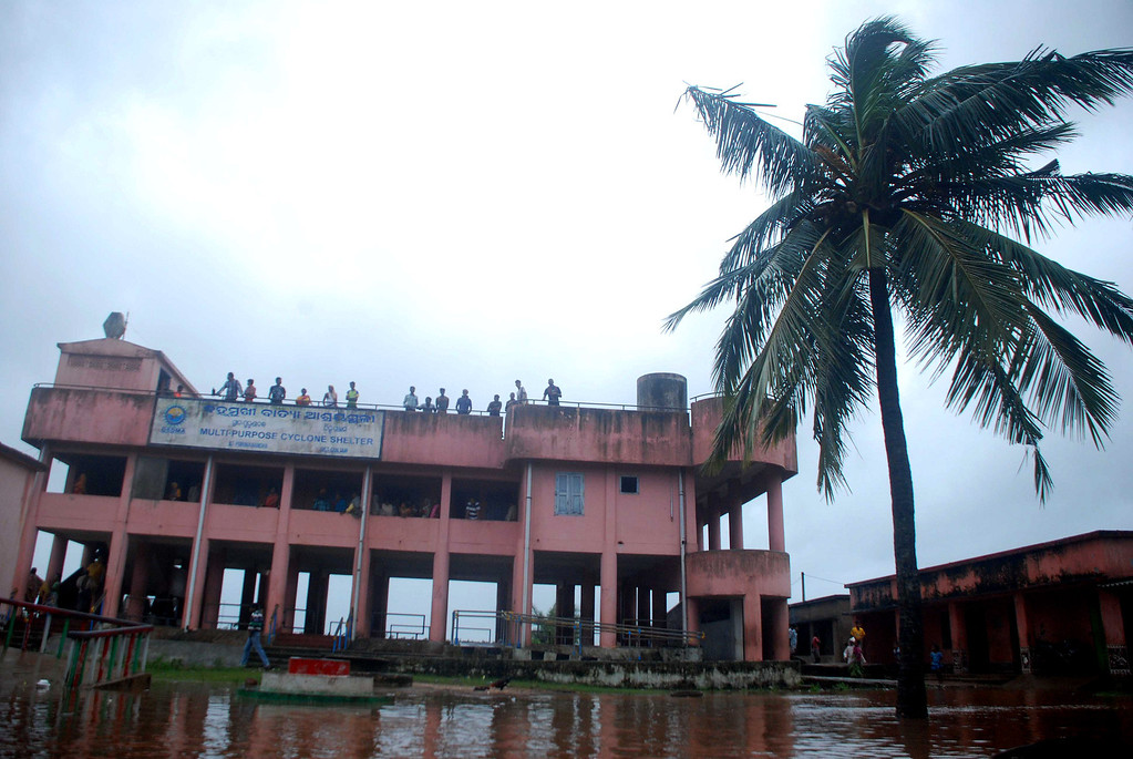 . Evacuated residents look out from a cyclone shelter in heavy winds and rain in Badabandha village near Gopalpur, about 190 kilometers south from eastern city Bhubaneswar on October 12, 2013.   Nearly half a million people have been evacuated from India\'s impoverished east coast ahead of a massive cyclone expected to make landfall on October 12 evening, disaster officials said.  ASIT KUMAR/AFP/Getty Images