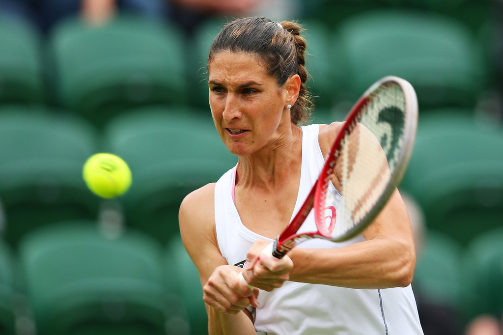 . Virginie Razzano of France plays a backhand during her Women\'s Singles match against Ana Ivanovic of Serbia on day one of the Wimbledon Lawn Tennis Championships at the All England Lawn Tennis and Croquet Club on June 24, 2013 in London, England.  (Photo by Julian Finney/Getty Images)