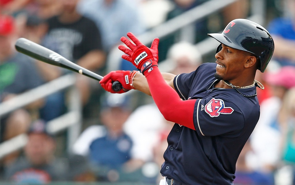 . In this Friday, March 3, 2017, photo, Cleveland Indians shortstop Francisco Lindor takes a swing during the first inning of a spring training baseball game against the Colorado Rockies in Goodyear, Ariz. In no time at all shortstop Lindor has become the Indians\' most valuable player and one of the league�s best. All Lindor did in his first full season was bat .301 in the regular season, .310 in the postseason, make the All-Star team, win a Gold Glove and display the confidence of a seasoned vet from start to finish. (AP Photo/Ross D. Franklin)