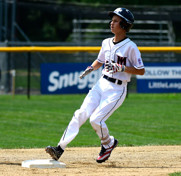 8/8/2018 Mike Orazzi | Staff Mid Island New York Little League's Gregory Bruno (24) on his way to second base at Breen Field in Bristol.