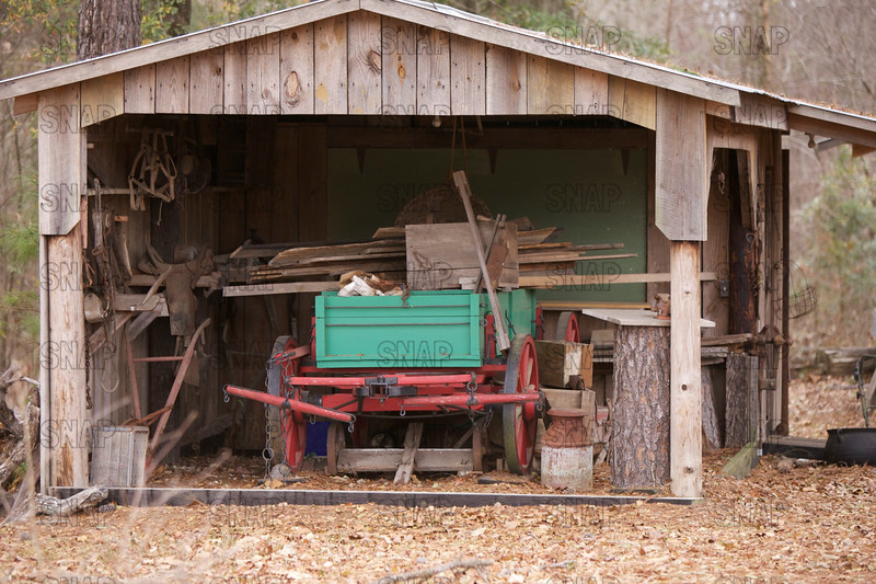 Old horsedrawn wagon in a shed in rural Alabama.
