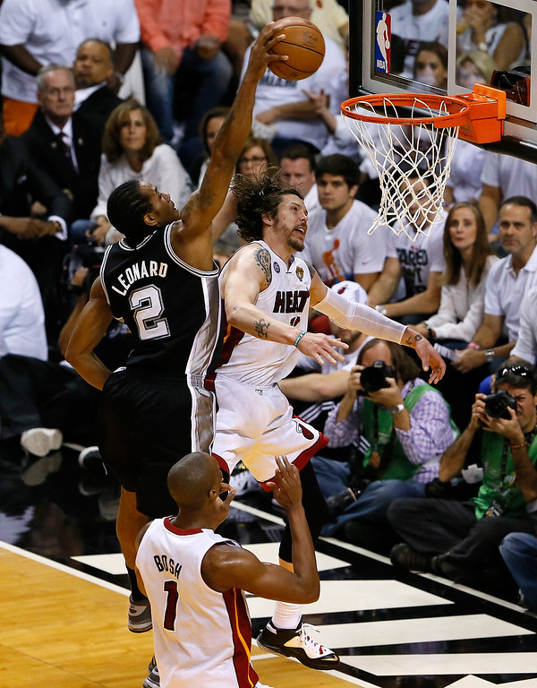 . Kawhi Leonard #2 of the San Antonio Spurs goes up for a dunk over Mike Miller #13 of the Miami Heat in the first quarter of Game Six of the 2013 NBA Finals at AmericanAirlines Arena on June 18, 2013 in Miami, Florida.   (Photo by Kevin C. Cox/Getty Images)