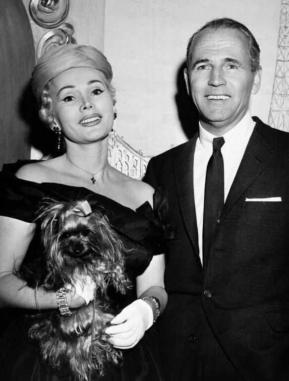 . Glamorous Zsa Zsa Gabor, one of the three glamorous Gabor sisters, and Hal B. Hayes, Los Angeles contractor who\'ll become her fourth husband on April 15, 1956 show their happiness as they pose together on March 30, 1956 in the New York costume jewelry shop of Jolie Gabor, Zsa Zsa\'s mother.    (AP Photo/Matty Zimmerman)