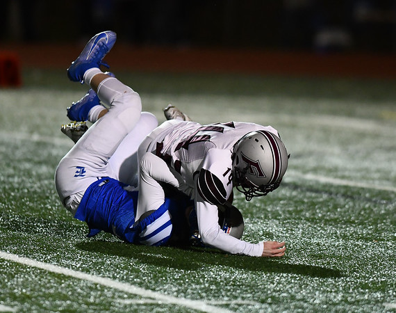 11/1/2019 Mike Orazzi | StaffrBristol Easterns Logan Schenck (15) and Farmingtons Devin Wagor (14) on what was ruled an interception by Farmington during Friday night football in Bristol.