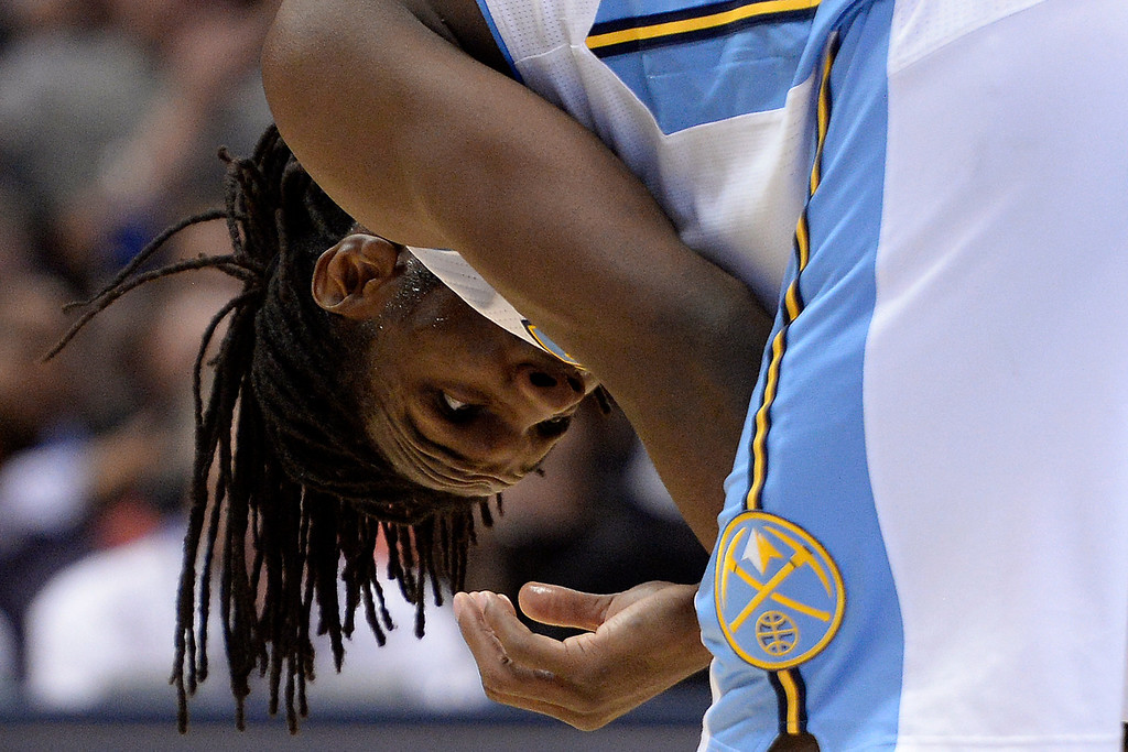 . Denver Nuggets forward Kenneth Faried (35) bends over after taking incidental contact against the Memphis Grizzlies during the third quarter of action. (Photo by AAron Ontiveroz/The Denver Post)