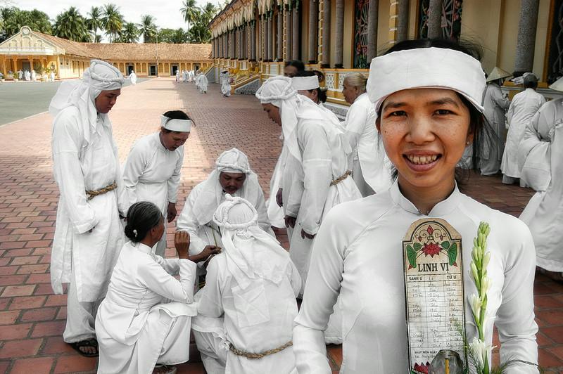 Worshipers gather outside the Cao Dai great Temple at Tay Ninh.  North of Saigon, Vietnam, 2008
