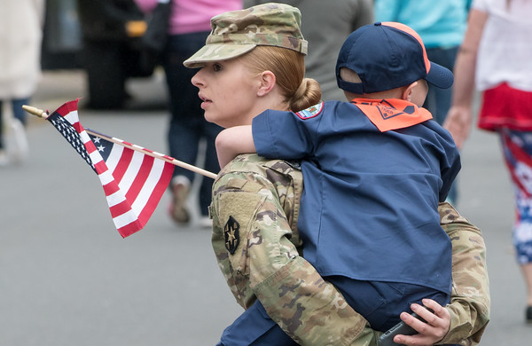 05/28/18 Wesley Bunnell   Staff A packed parade route greeted marchers in the 2018 Memorial Day Parade in Southington on Monday morning. An army specialist carries a young cub scout at the end of the parade route on Main St.