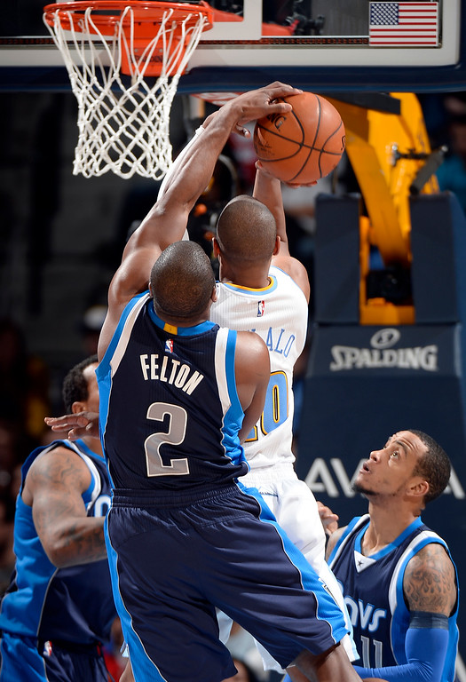 . DENVER, CO - JANUARY 14: Dallas Mavericks guard Raymond Felton (2) blocks a shot by Denver Nuggets guard Arron Afflalo (10) during the third quarter January 14, 2015 at Pepsi Center. (Photo By John Leyba/The Denver Post)