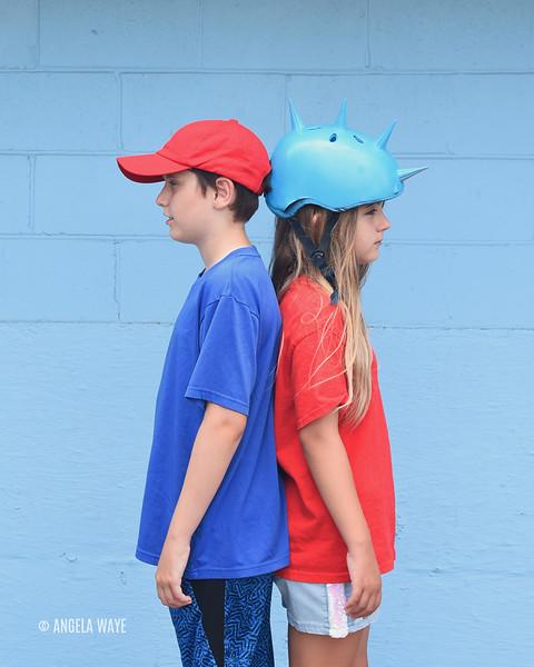 Children Standing Back to Back