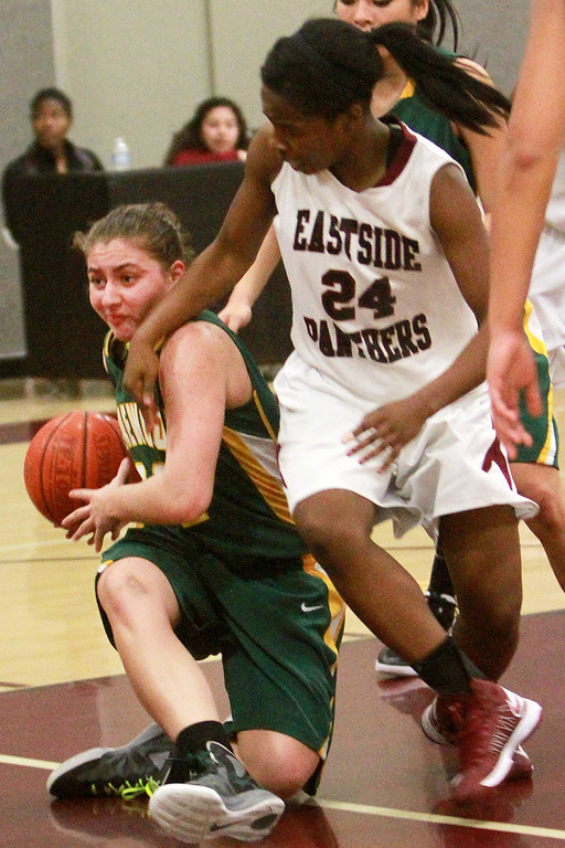 . Pinewood\'s Kendahl Wallis-Lang(cq) recovers a rebound against Eastside Prep\'s Alexus Simon during a game in the second quarter at Eastside Prep High School on Tuesday, Feb. 5, 2013.     (Kirstina Sangsahachart/ Daily News)