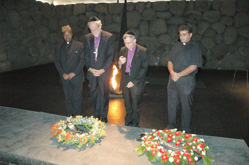 LWF Leaders lay a wreath Sept. 2 at the Children's Memorial at Yad Vashem, the Jewish peoples' memorial to the Holocaust in Jerusalem.  From left are Dr. Ishmael Noko, LWF general secretary; Bishop Mark Hanson, ELCA presiding bishop and LWF president and the Bishop Munib Younan, LWF vice president, and the Rev. Ramez A'nsara, pastor of Evangelical Lutheran Church of Hope, Ramallah.