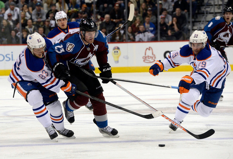 . DENVER, CO. - FEBRUARY 2ND: Milan Hejduk, Colorado Avalanche, advances the puck against Ales Hemsky, left, and Sam Gagner, the Edmonton Oilers in the third period at the Pepsi Center in Denver Colorado, February 2nd, 2013. Avalanche won 3-1.  (Photo By Andy Cross / The Denver Post)