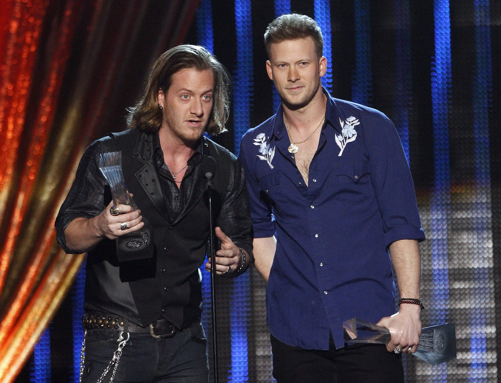 ". Tyler Hubbard, left, and Brian Kelley of Florida Georgia Line accept their award at CMT ""Artists of the Year\"" show held at the Music City Center on Tuesday, Dec. 3, 2013, in Nashville, Tenn. (Photo by Wade Payne/Invision/AP)"