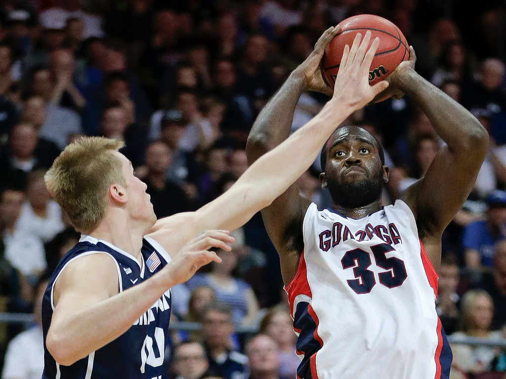 . Gonzaga\'s Sam Dower Jr. (35) puts up a shot against BYU\'s Eric Mika in the first half of the NCAA West Coast Conference tournament championship college basketball game, Tuesday, March 11, 2014, in Las Vegas. (AP Photo/Julie Jacobson)