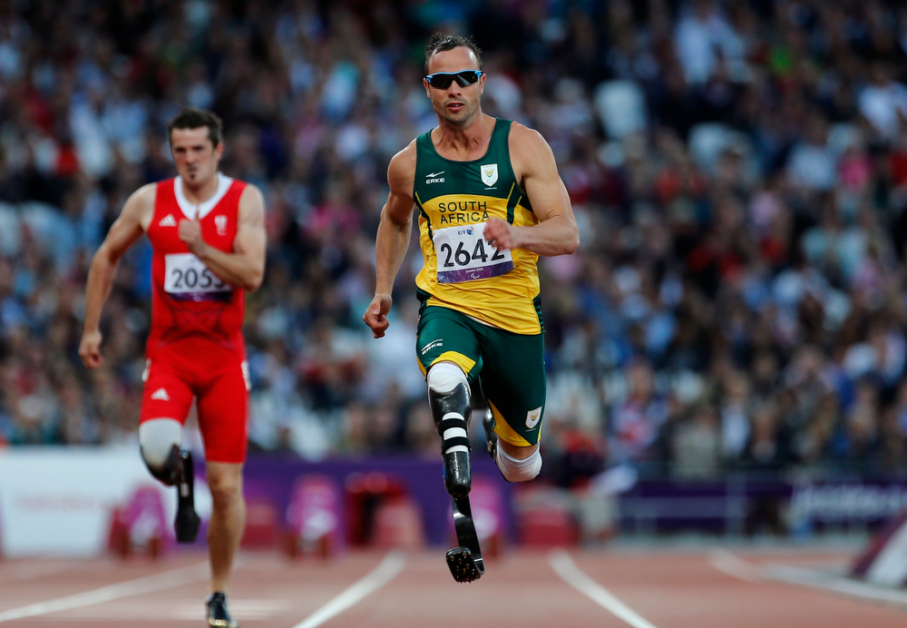 Description of . In this Wednesday, Sept. 5, 2012 file photo, South Africa's Oscar Pistorius competes during Men's 100m T44 round 1 at the 2012 Paralympics in London. Olympic sprinter Oscar Pistorius has been arrested after a 30-year-old woman was shot dead at his home in South Africa. Police say Pistorius, a double-amputee known as