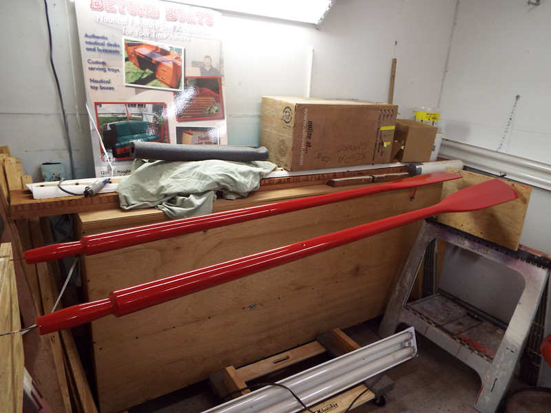 Oars after three coats of red have been applied.