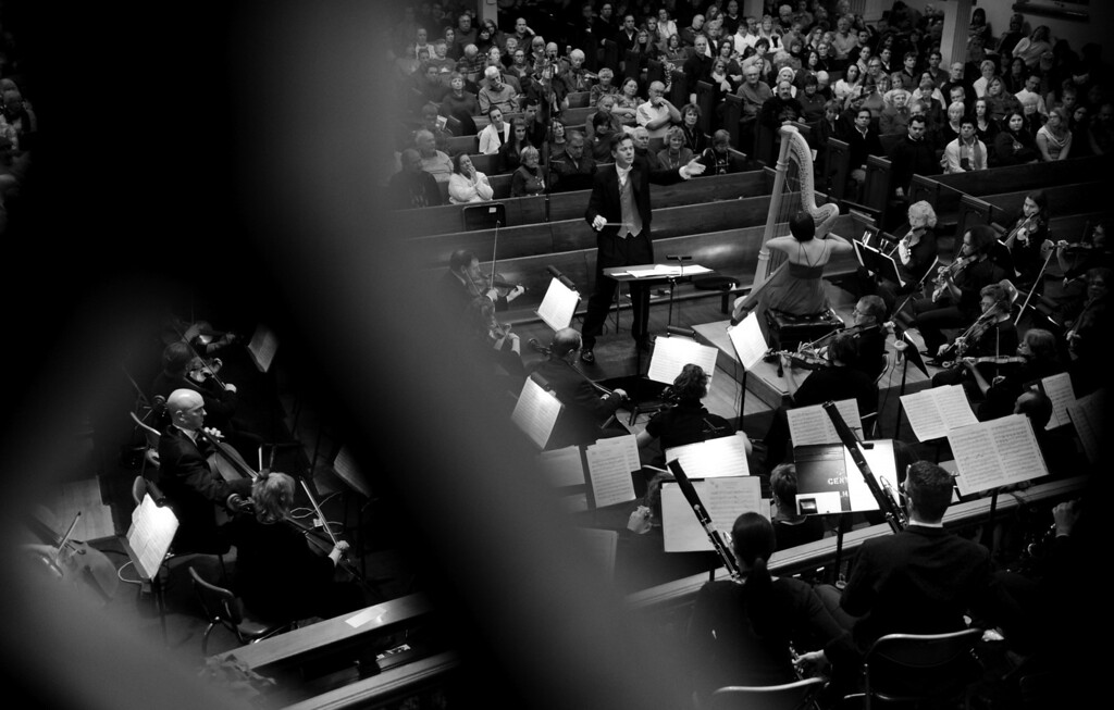 """. Music Director Adam Flatt conducts the Denver Philharmonic Orchestra, featuring harpist Emily Levin during a performance at the KPOF Concert Hall in Denver, CO, Friday December 14, 2012. \""""I have my eye on each concert evening\'s flow and duration and all that stuff. I have to introduce a certain amount of variety in the programming... It\'s like nutrition, there has to be a certain diet to programming that requires us all to hone certain skills and keep sharp. So I introduce what I think is the right kind of diet for, not only our audience,  but for our musicians. So we have a full season of breadth and interest.� Craig F. Walker, The Denver Post"""