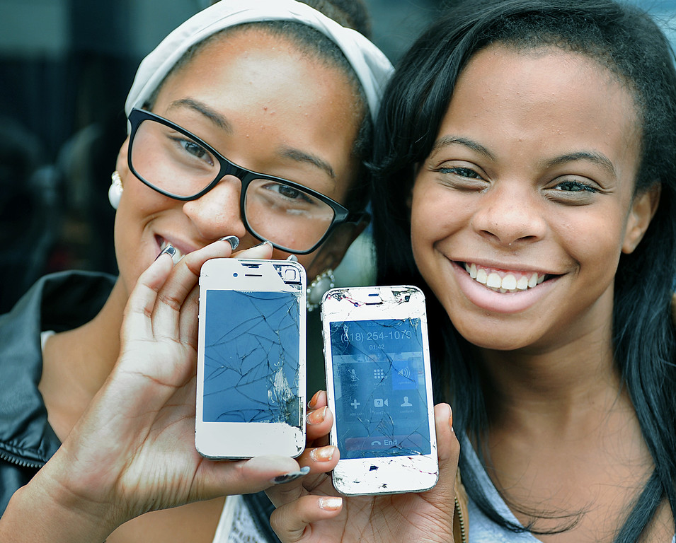 . Lexi Cooper, left, of Arcadia  and Kihilyn Craig of Monrovia at Apple Store in Old Pasadena waiting in line  to replace their old IPhones that have been through hell & back  with the release of the new IPhone 5S and IPhone 5C Friday, September 20, 2013. (Photos by Walt Mancini/Pasadena Star-News)