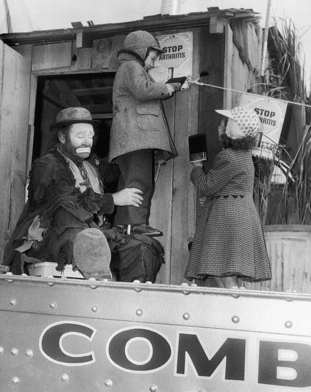. Emmett Kelly, famed circus clown, entertains two youngsters, poster children for the New York Arthritis and Rheumatism Foundation, as the Ringling Brothers, Barnum and Bailey Circus arrives in New York on March 27, 1955. Standing on one of the railroad gondolas in the Harlem yards of the New York, New Haven and Hartford Railroad are Jeffrey Goldberg, center, and Alice Fitzpatrick of Brooklyn, New York. (AP Photo)